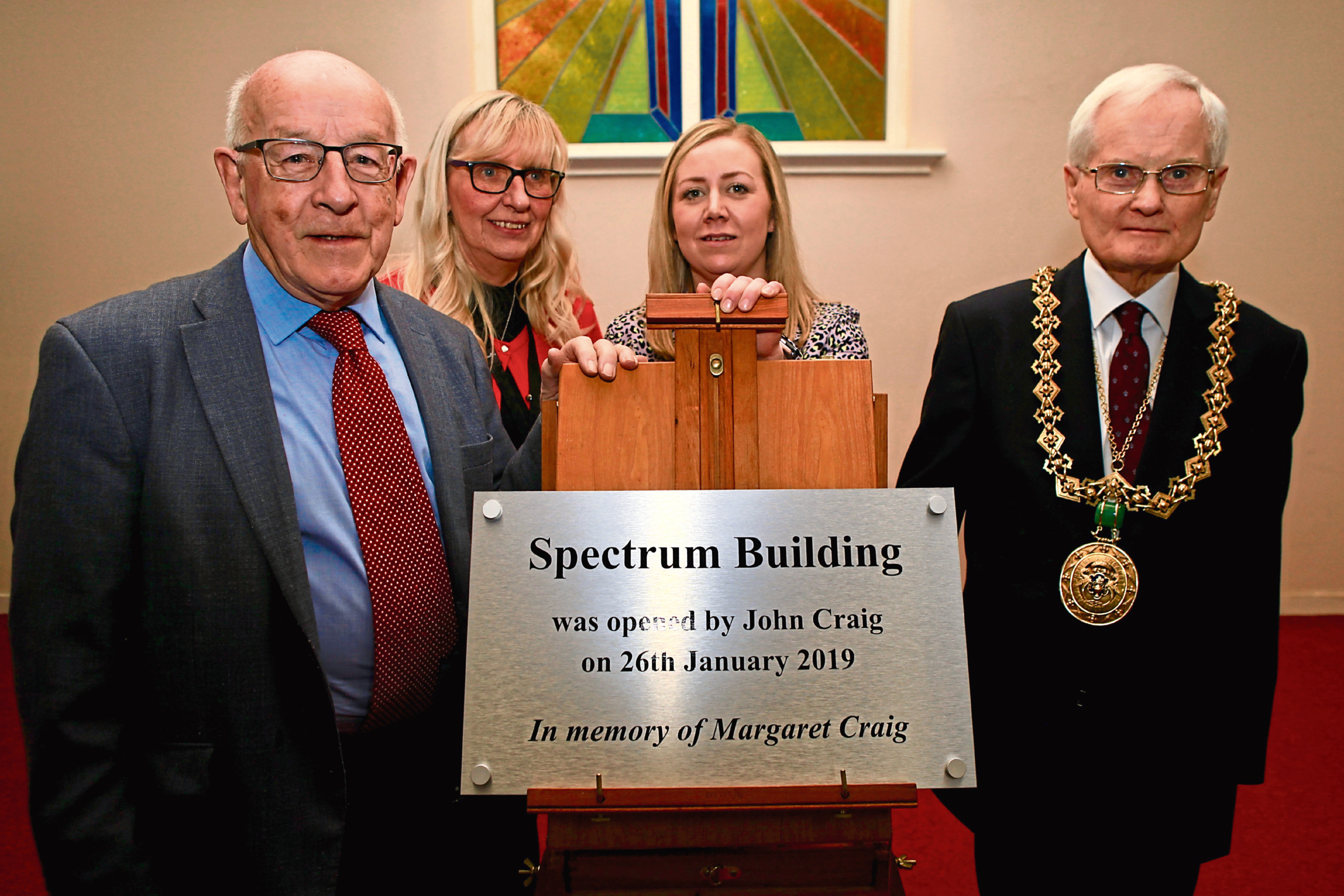 From left: John Craig, Spectrum deputy manager, Bev McKelvie, Spectrum chair, Kirsty Anderson and Lord Provost Ian Borthwick when the charity moved to its premises in Claverhouse Road.