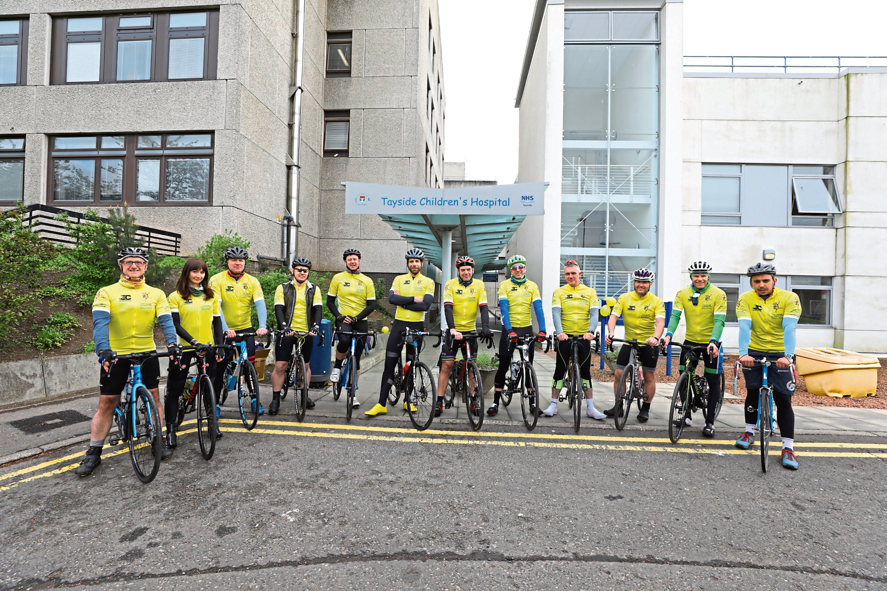 The cyclists lined up outside the Tayside Children's Hospital, with Mark Beaumont, sixth from left, leading the way.