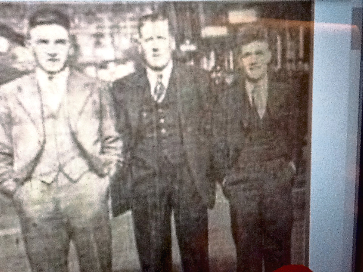 Dickie Boag, of Lochee Harp JFC, on the far right, and Jimmy Briggs (Dundee Violet JFC) on on the far left, with a committee member.