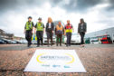 Picture shows, from left, PC Kirsten Kiddie, Inspector Kerry Lynch, Christine McGlasson, Xplore Dundee operations director George King, council community safety co-ordinator Steve Laurence and Gillian Lamb, of the council's antisocial behaviour team