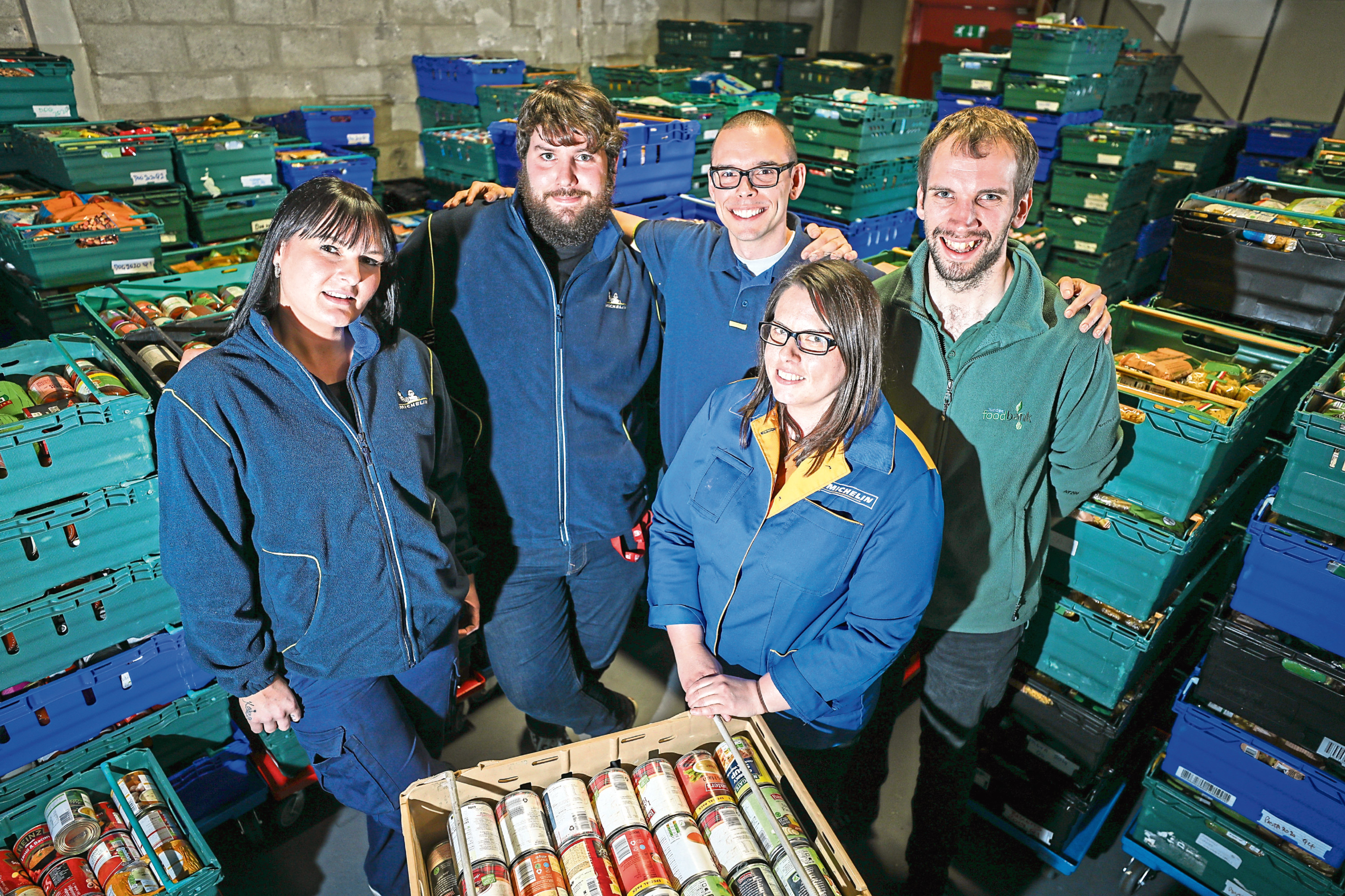 Michelin staff Michelle Johnstone, Scott Webster, Peter Blanchard and Louise Smart presenting the food to Michael Calder - Stock Coordinator at Dundee Foodbank.