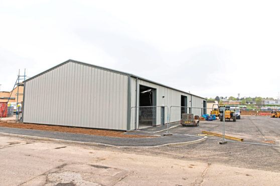 The units near completion on Carlunie Road, which could become a new gym.