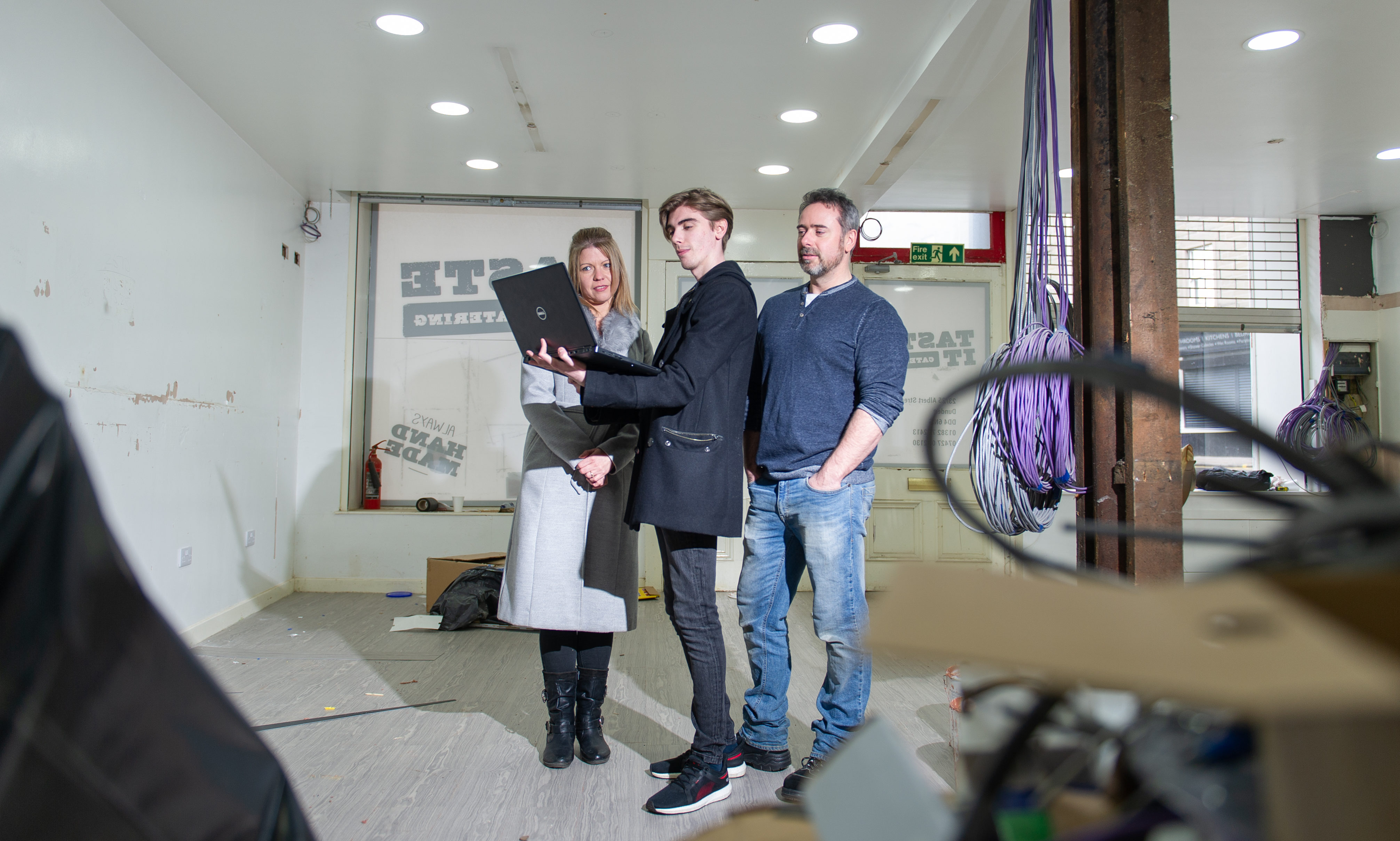 Ashley Donaldson, Drew Douglas and Gavin Innes in the retail unit which is being transformed into a computer games hub