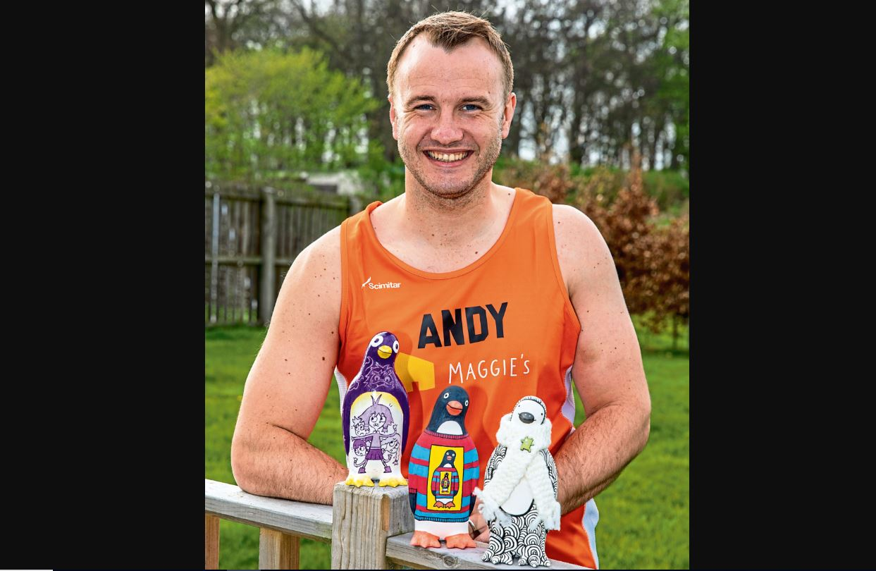 Andy with the penguins which will be auctioned off.