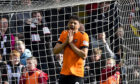 Dundee United's Osman Sow looks dejected as his penalty hits the post