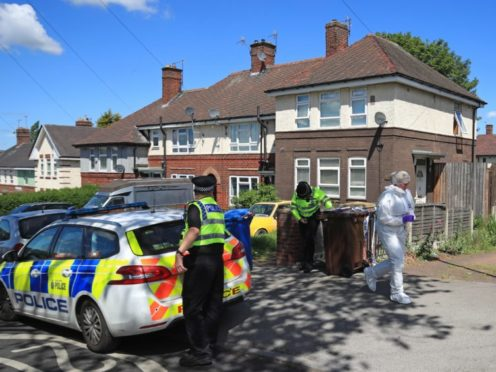 Police at a property on Gregg House Road in Shiregreen, Sheffield (Danny Lawson/PA)
