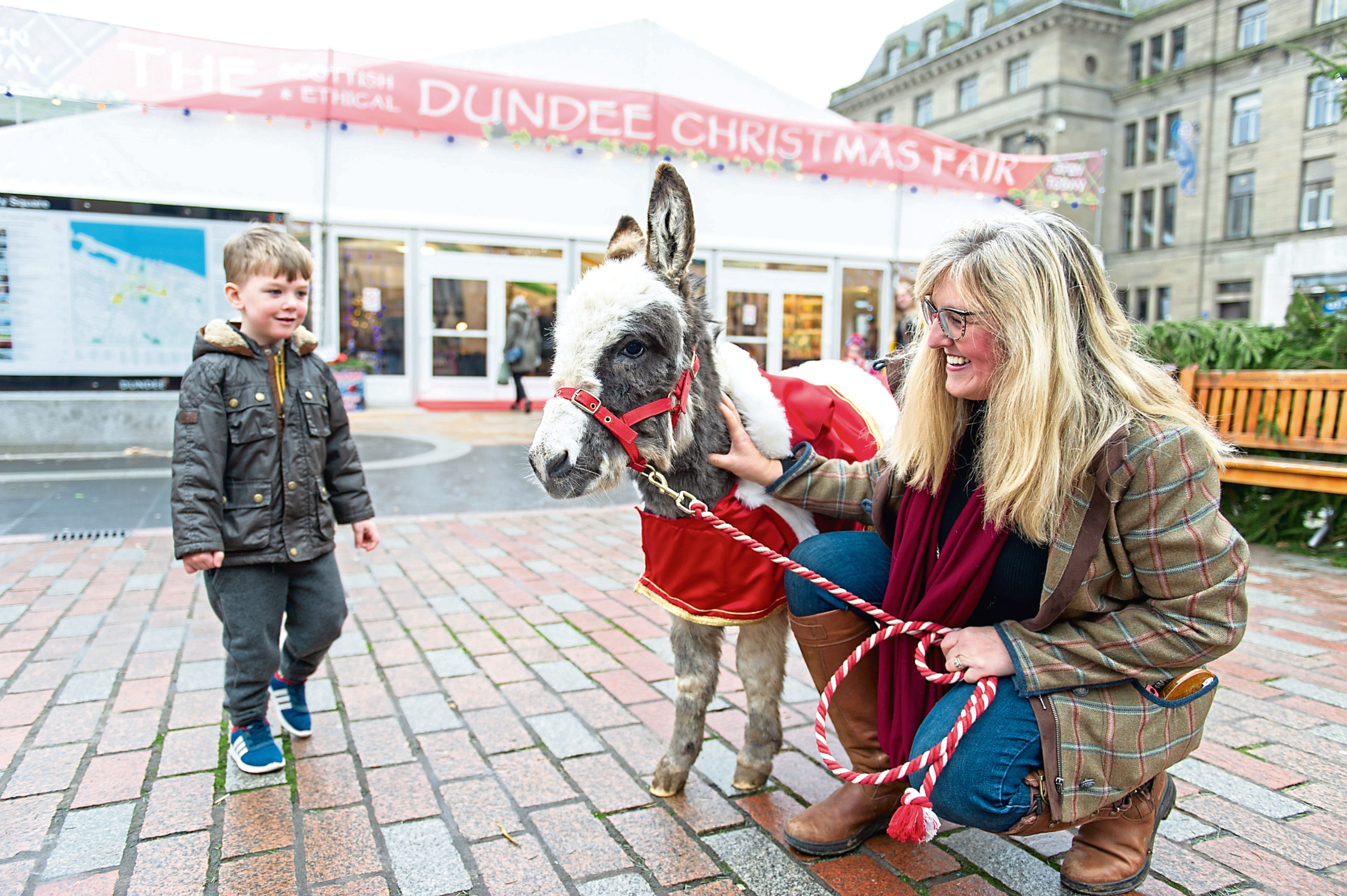 Little Donkey and Alison Wiseman greet Rory Clark, 4, at the door of the Ethical Christmas Fair in 2018.  Council leader John Alexander has called for more entertainment to be provided using the council's festive budget.