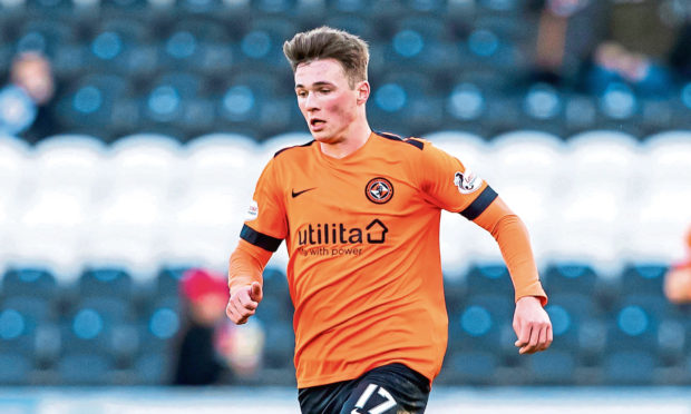Jamie Robson in action for Dundee United.