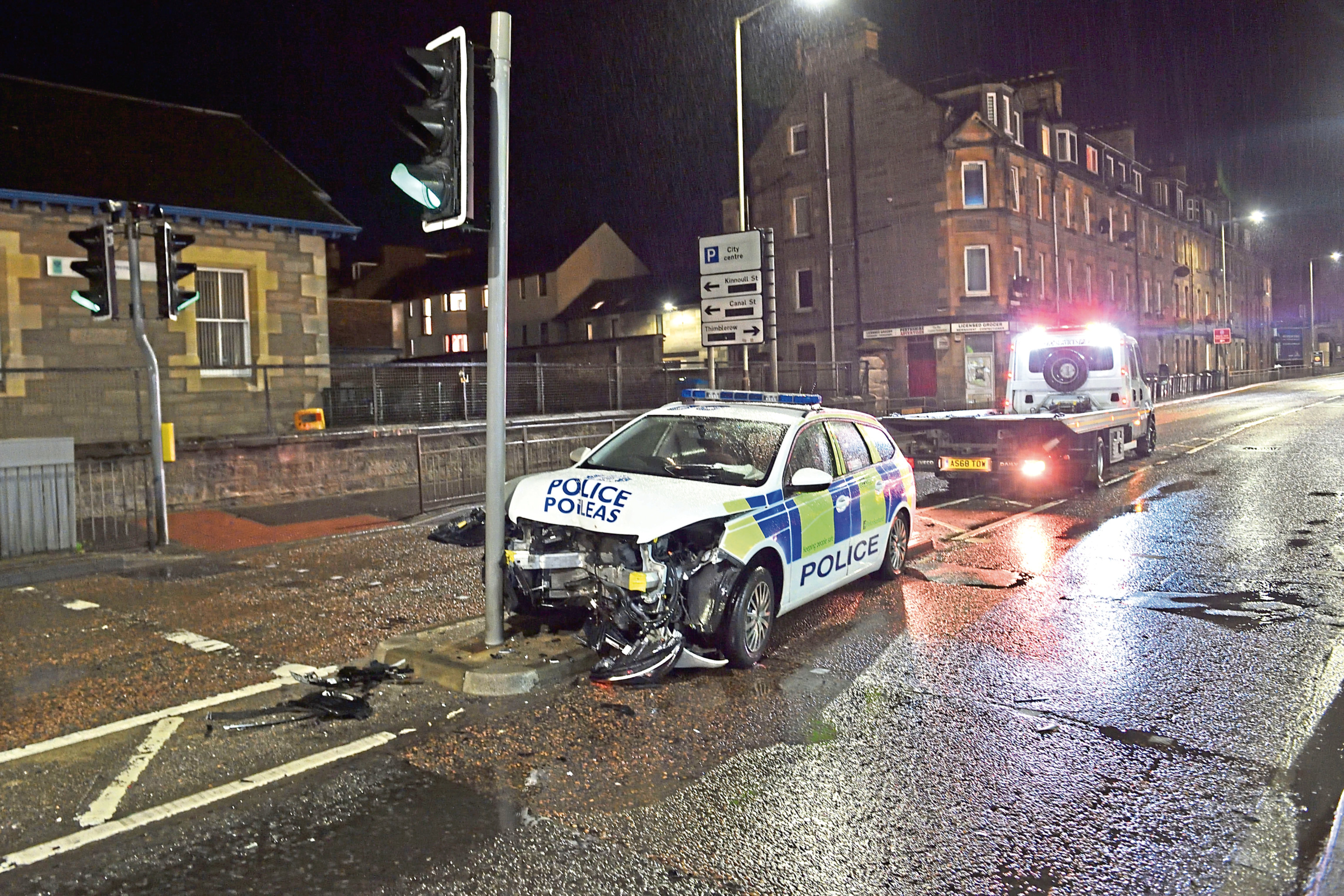The police car was badly damaged in the crash on Barrack Street, Perth