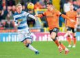 Morton's Dylan Dykes (L) battles with Dundee United's Calum Butcher during a previous tie.