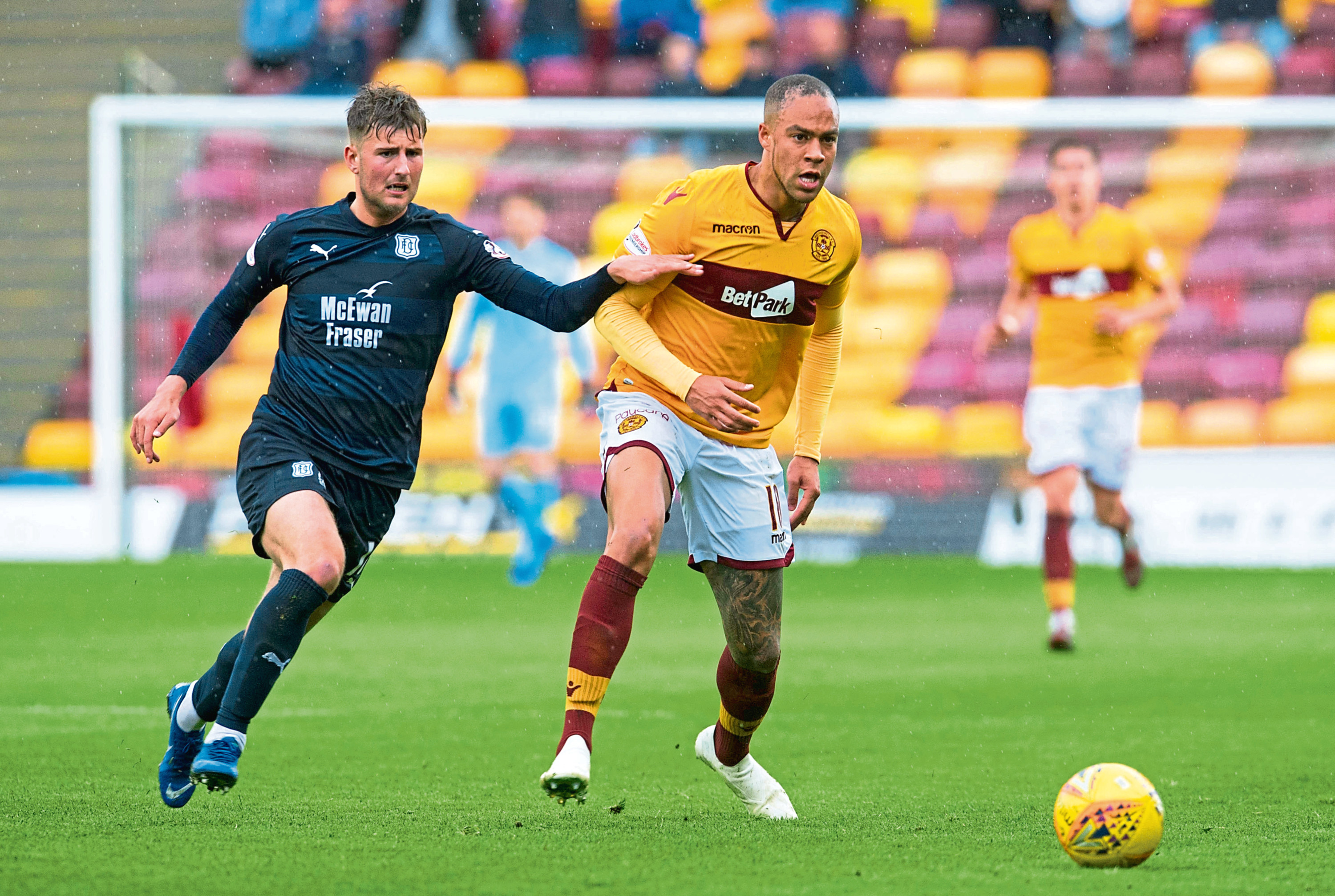 Dundee's Ethan Robson (left) in action with Motherwell's Charles Dunne