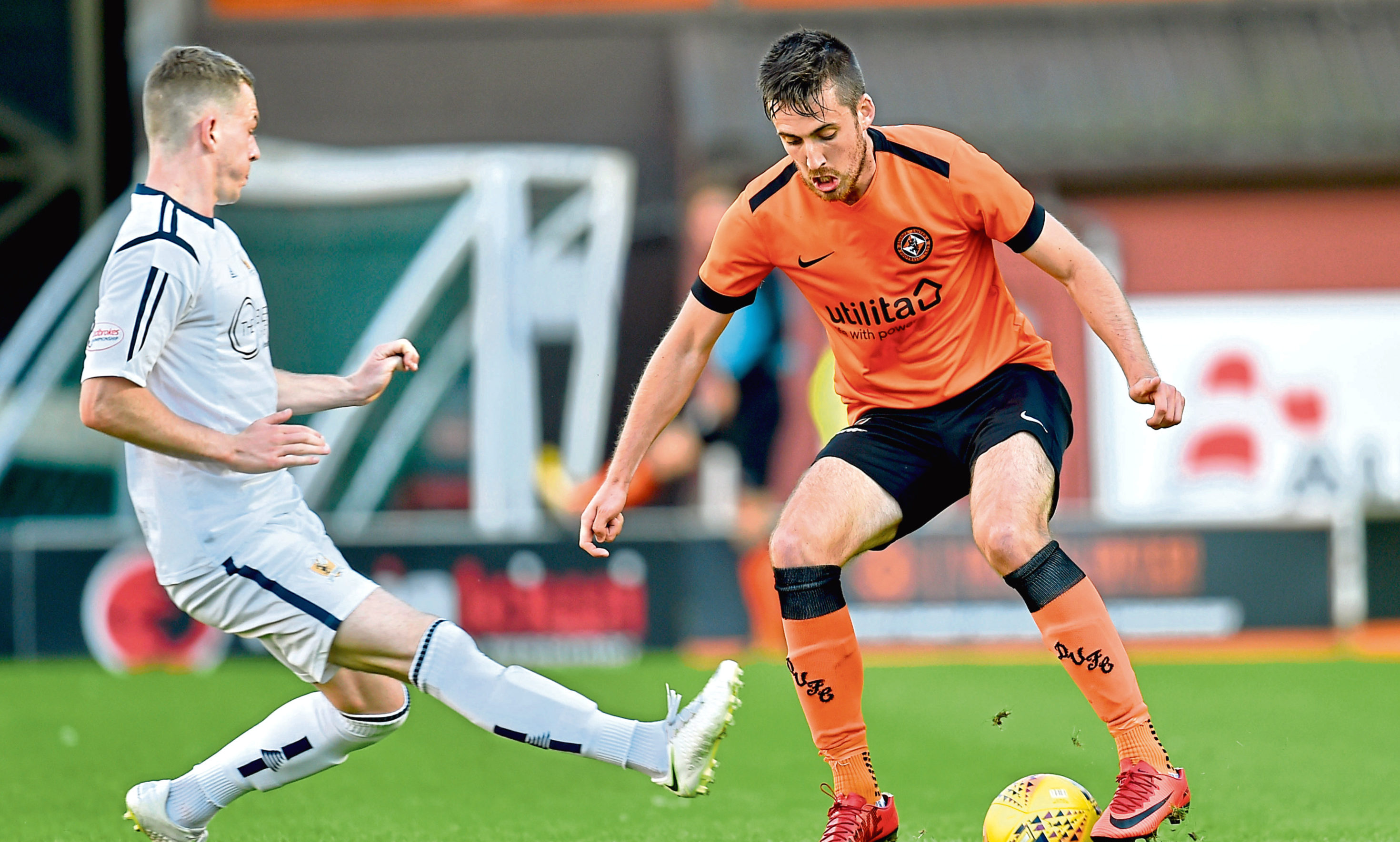 Dundee United's Callum Booth in action against Alloa's Adam Brown