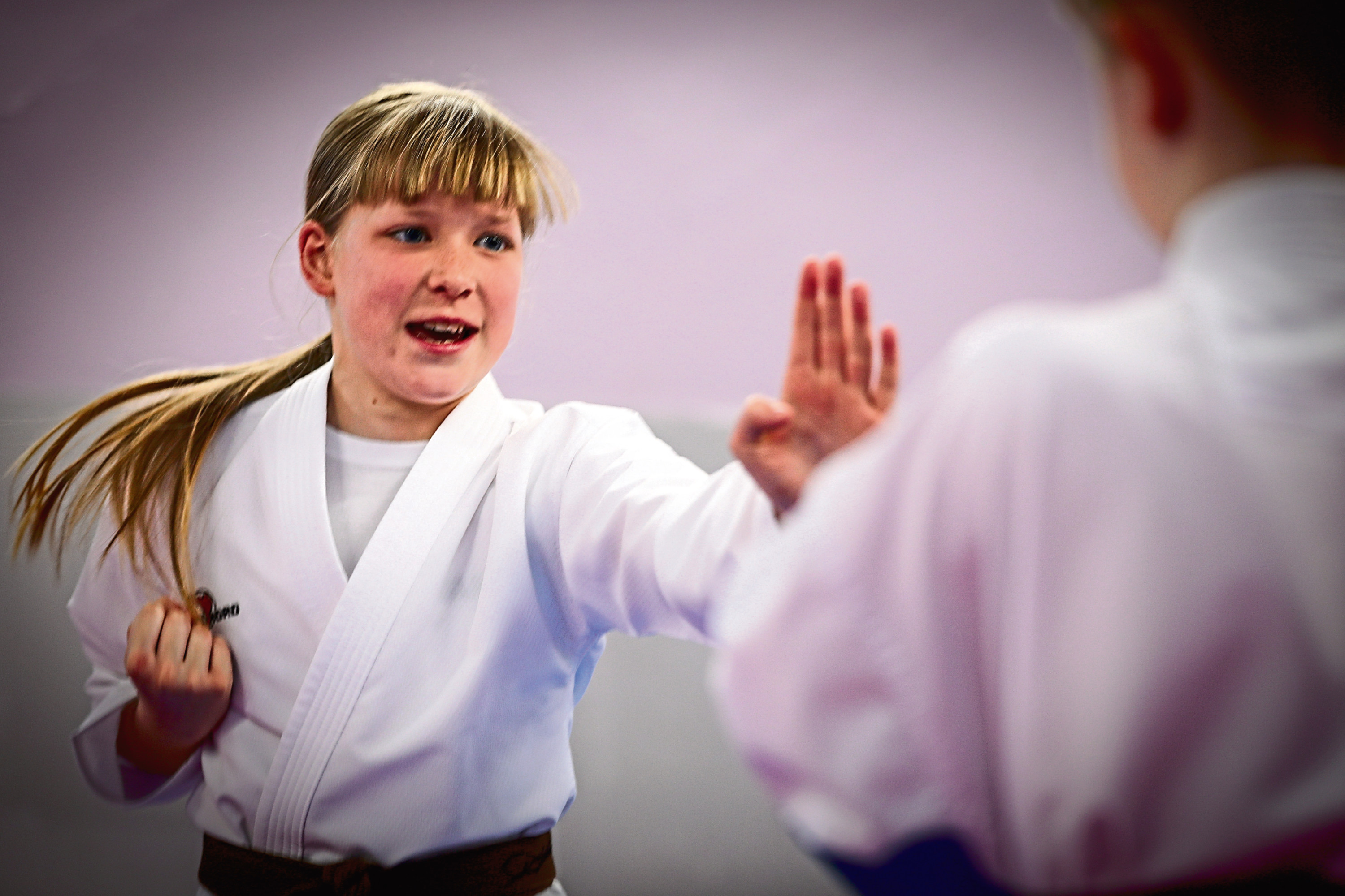 Daisy Hutchison sparring at Sport Karate East in Dundee.