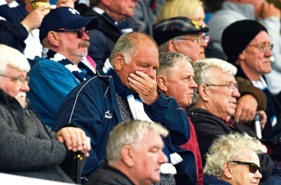 Dundee fan watches on in anguish as the Dark Blues' fate is sealed.