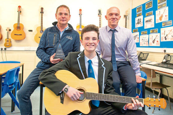Picture shows; left to right, Paul Smith (donated trophy for Senior Vocalist of the Year), Adam Elder and music teacher Stuart Brand
