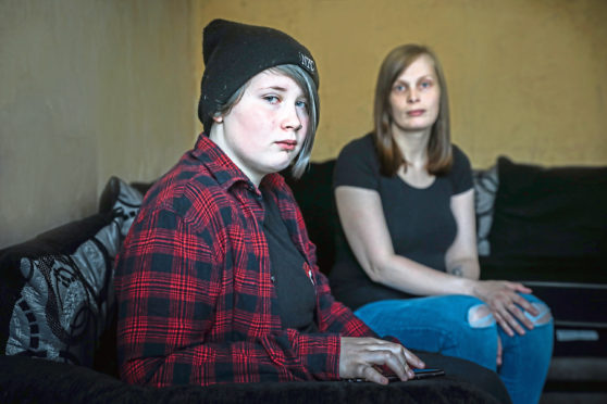 Ash Dodds, 14, with his mum Sabrina Bannister.
