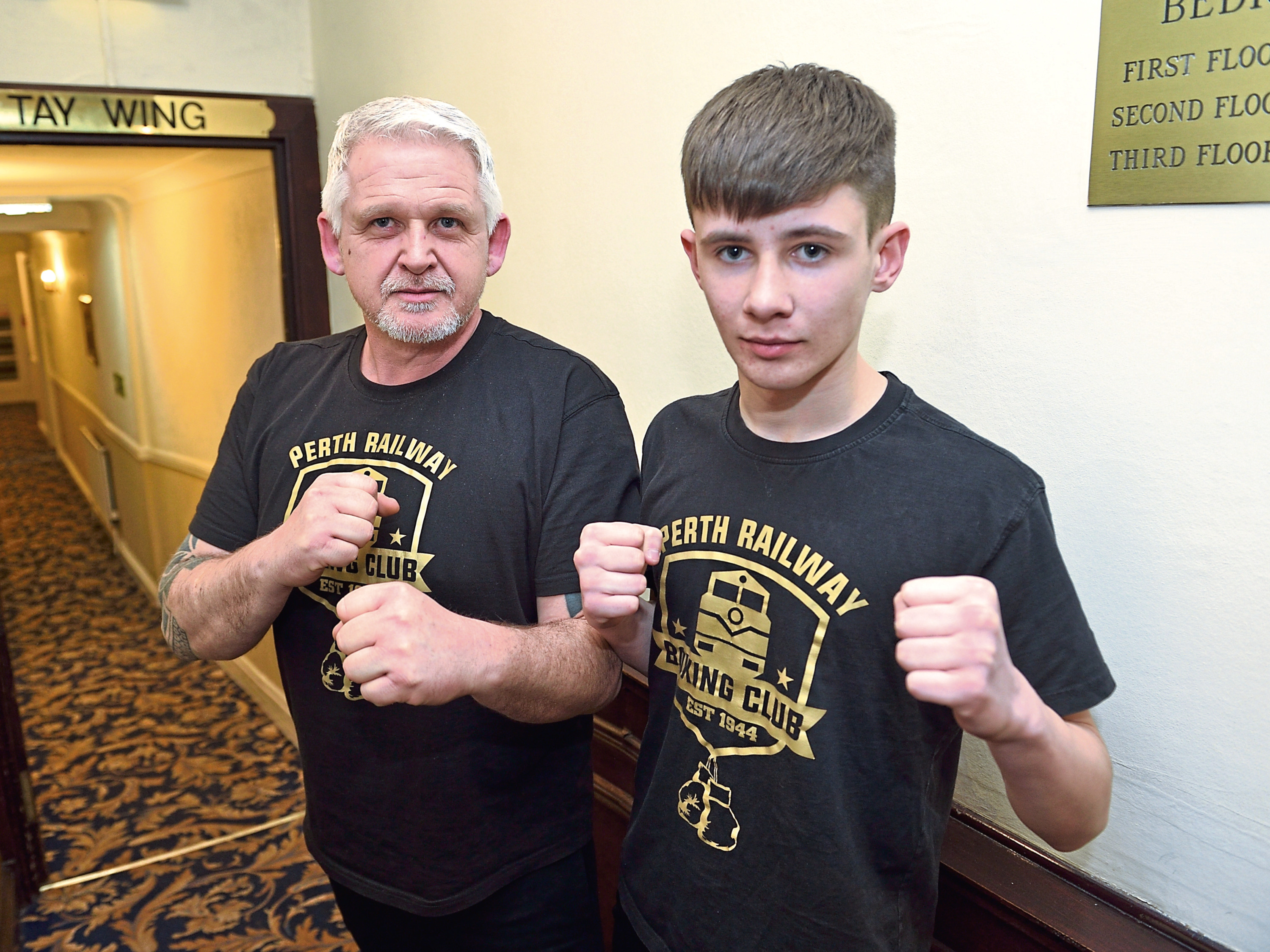 Perth Railway boxer Finn Scott and his coach, dad Gordon