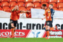 Dundee United's Mark Connolly celebrates with  Calum Butcher.