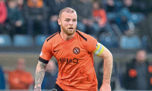 Dundee United central defender Mark Connolly is facing at least a month on the sidelines after suffering a serious injury