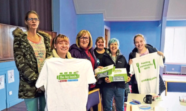 Picture shows organisers and volunteers with some Big Lunch merchandise