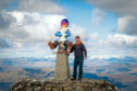 Douglas Roulston with a statue of Oor Wullie to the top of Ben Nevis