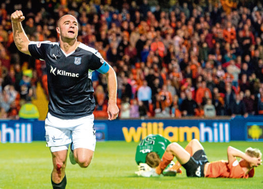 James McPake scoring  a last minute leveller for Dundee.
