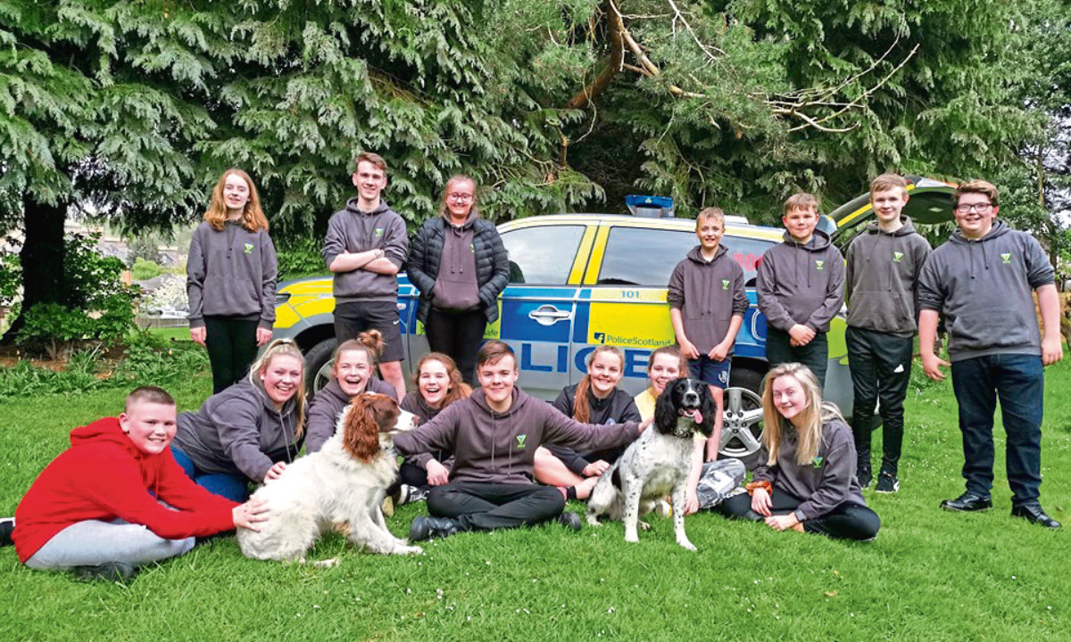 Police Scotland Youth Volunteers with police dog visitors.
