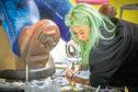 Artist Amy McIntosh working on her statue