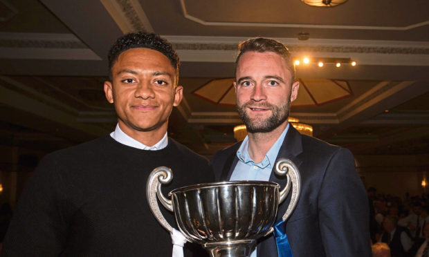 James McPake presents Nathan Ralph with the Andrew De Vries trophy as Dundee's player of the year for season 2018-19