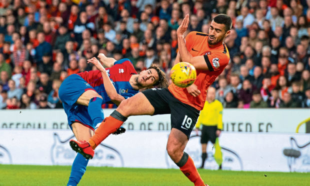 Dundee United's Rachid Bouhenna (right)