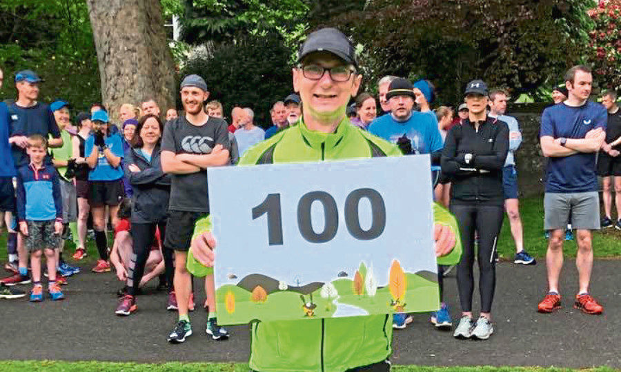 Andy McLeish is congratulated on his 100th Park Run