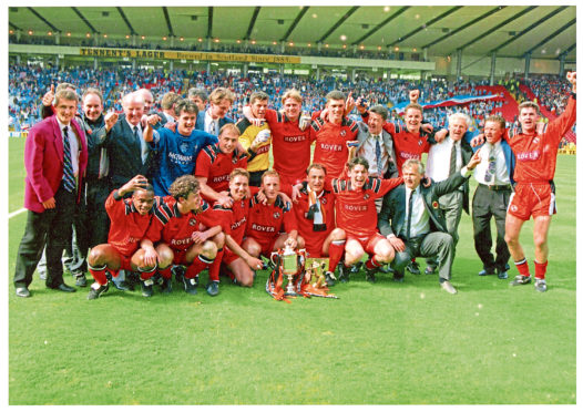 Dundee United players celebrate after their 1994 Scottish Cup win over Rangers