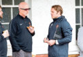 Manager Robbie Neilson (right) with owner Mark Ogren.