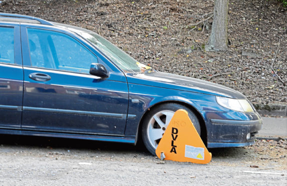 A clamped car in Dundee. (Stock image).