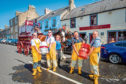 In the centre is Halina McAllister (Manager, Fishermans Tavern) alongside (left to right) Kris Stuart, Billy Brannan, Kenny Watson and Murray Brown (Broughty Ferry Lifeboat RNLI crew).