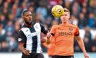 Dundee United's Paul Watson battles with St Mirren's Duckens Nazon