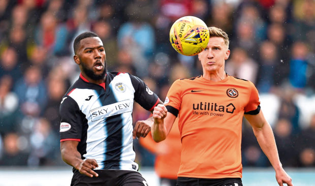 Dundee United's Paul Watson battles with St Mirren's Duckens Nazon