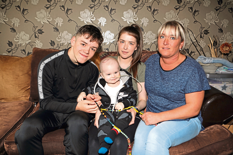 Ryan, with mum Chantelle Jones, gran Claire Stewart and uncle Josh Hamilton.