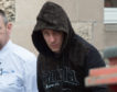 Mantas Varanauskas being escorted to the prison van from Elgin Sheriff Court.