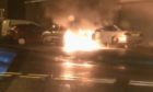A car on fire in Duncraig Road, Charleston, Dundee