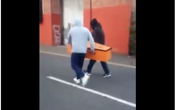 The two men with the tangerine coffin.
