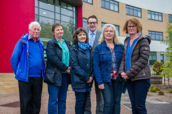 The Friends of Grove Academy who discussed the unveiling ceremony, from left: John Hamilton, Karen O'Rourke, Elaine McKeown, John Anderson (Principal Teacher of History), Pamela Stewart and Julie Lynch.