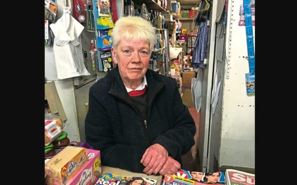Moira Jack was shoved to the ground while working at Paterson's newsagents on Strathmartine Road before having £180 nicked from her purse by George Reilly.