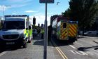 The emergency services on Dock Street after a woman was hit by a bus.