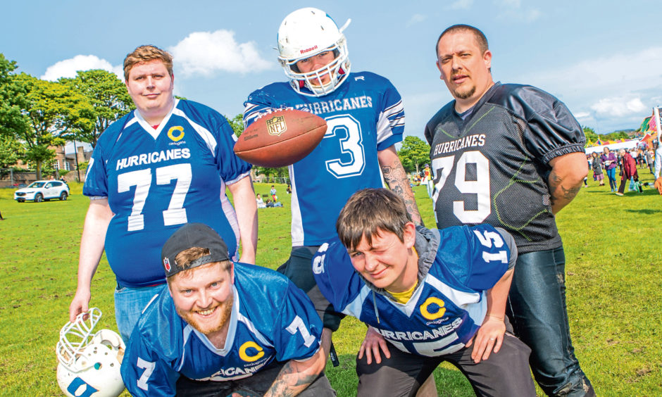 Scott Ritchie (back centre) with other members of the Dundee Hurricanes American Football team, there to drum up support and recruit new members.
