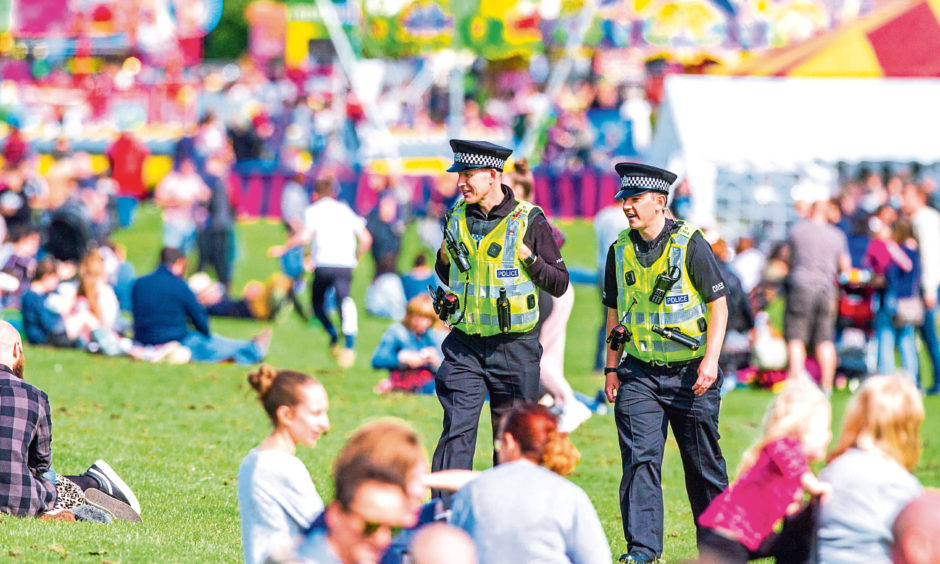 Police walk around at the festival.