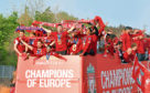 Liverpool players and staff on the bus during the Champions League Winners Parade in Liverpool.