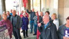 Stuart Fairweather addresses a crowd of union members outside the City Chambers