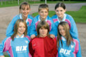 Lana Clelland (back row, middle) and Lisa Evans (front, right) as young players at St Johnstone Girls in 2006