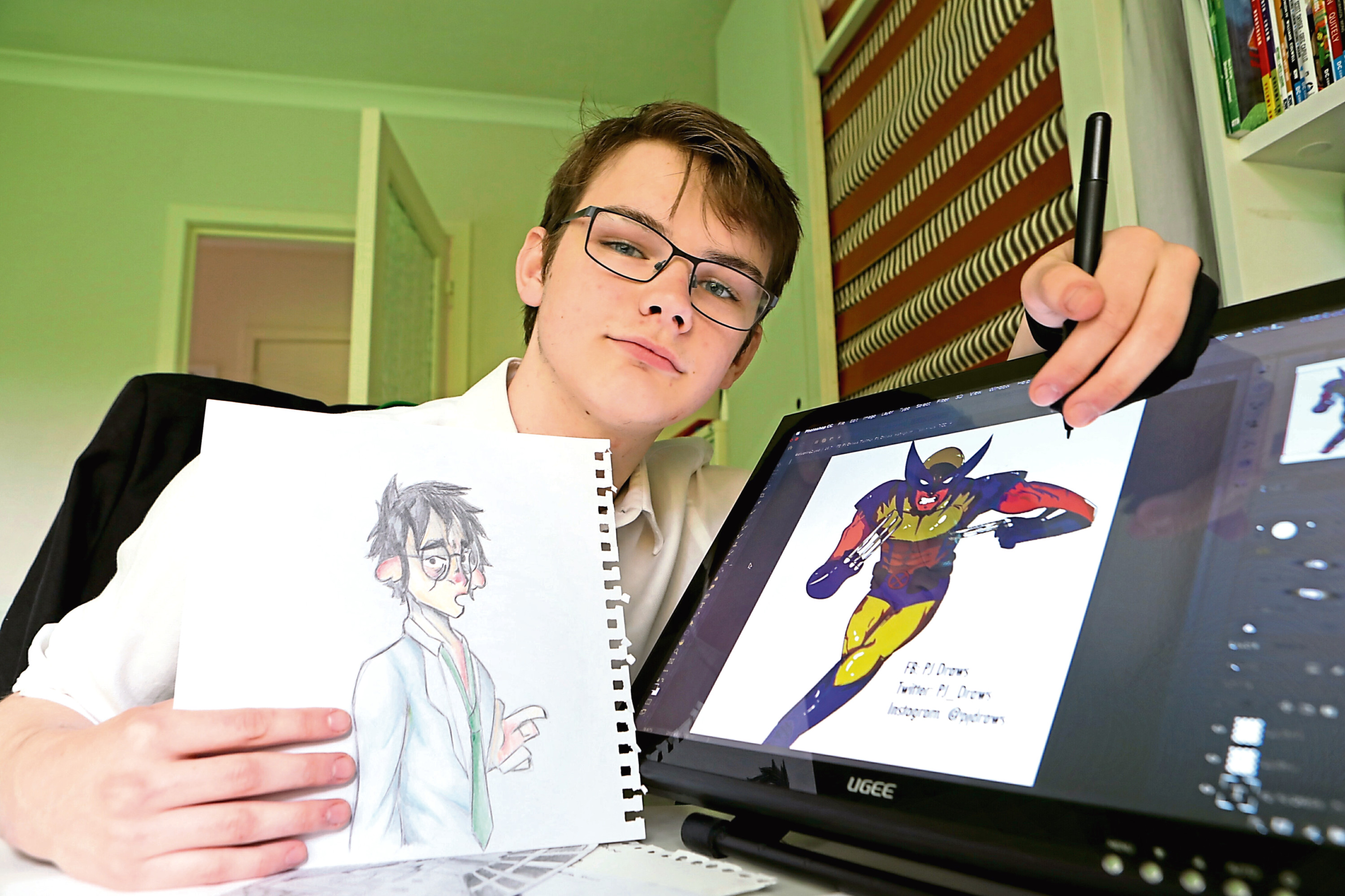 Paul Fairweather has been given a place at Duncan of Jordanstone to study art. He's seen holding some of his drawings.